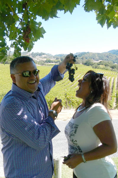 Tasting grapes while on tour with Healdsburg Wine Tours